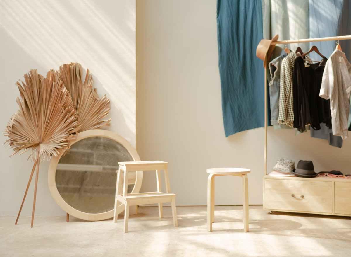 white wooden barstool and white round white mirror frame