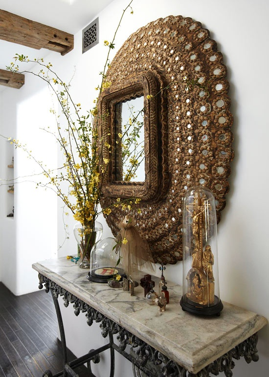 Beautiful Indian mirror over a French pastry table, great combination