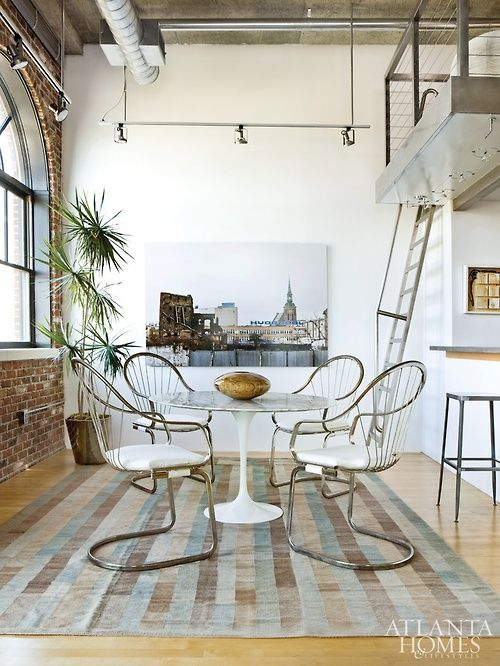 Tulip table in a loft via The Bower Birds