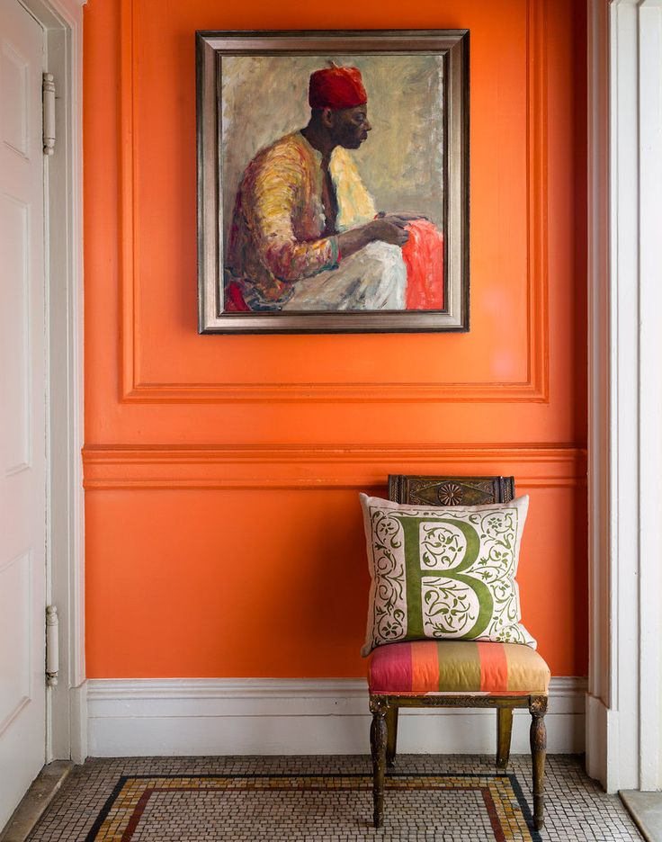 Orange wall in designer Sheila Bridges' New York apartment via the New York Times