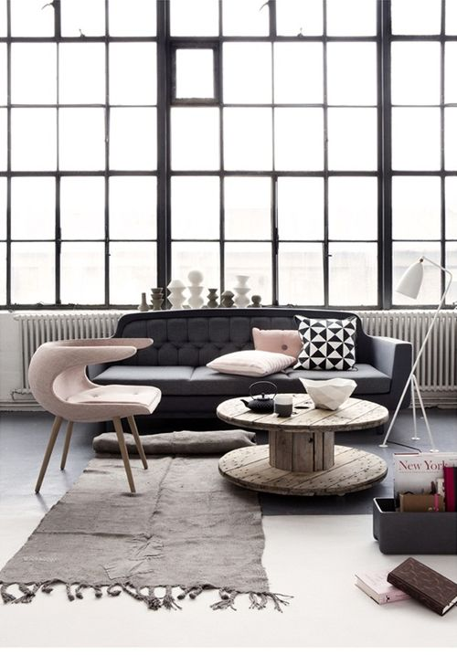 I love this pink chair, anyone knows who the designer is?