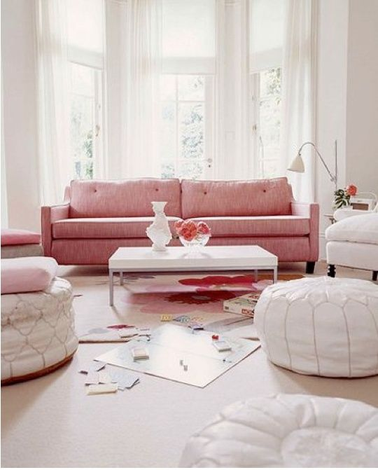 Pink sofa with white Maroccon leather poofs, girly girly but I love it - via Home-2-Me