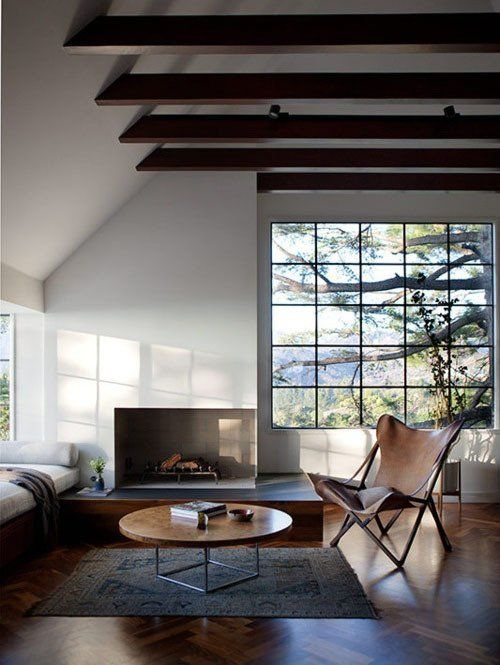 I love this room, panorama window, double volume ceiling, daybed for daydreaming, fireplace and of course a butterfly - via Apartment Therapy