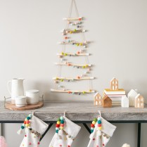 An easy Christmas tree on the wall is so cute!