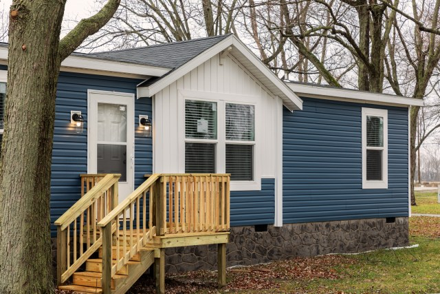Manufactured home with steps leading to the front door.