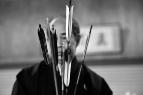 Framed by arrows, Miyasaka Kazuhisa is seen in his archery dojo on Friday October 28, 2016 in Yudanaka, Japan. Kazuhisa runs a small inn next to his dojo where he teaches Kyudo archery.