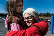 Emmeline Harris, 8, hugs Abigail Eggleston, 7, while selling cookies with their Girl Scout troop on Saturday Feb. 4, 2017 in Madison Heights, Va.