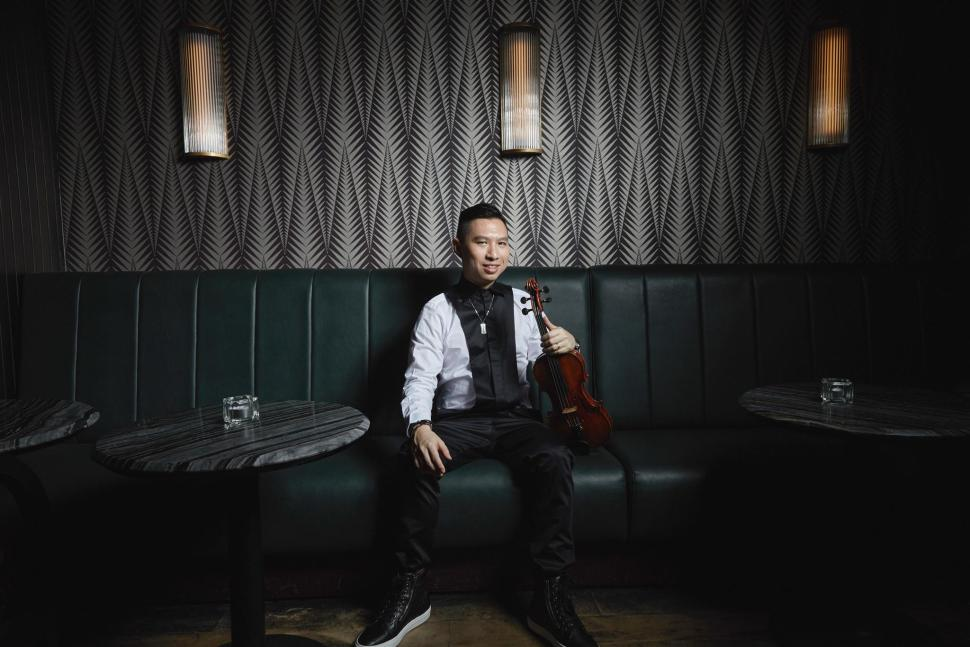 """Lester brought VOX together as part of his bigger ambition to inject cool and street cred into classical instruments. With VOX, he feels free to explore and create new sounds with his violin, Kosmo because """"there are no restrictions or limitations to the way we play and express ourselves"""". In addition to VOX, Lester has also gathered much experience over the years, as a violinist in various orchestras including the Singapore National Youth Orchestra and The Philharmonic Orchestra."""