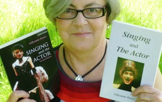 Dr Gillyanne Kayes with copies of her #1 bestseller Singing and the Actor