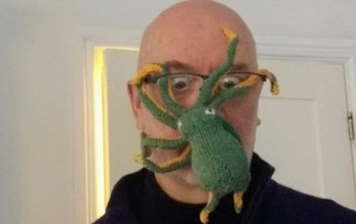 Jeremy with an octopus on his face (hand-knitted)