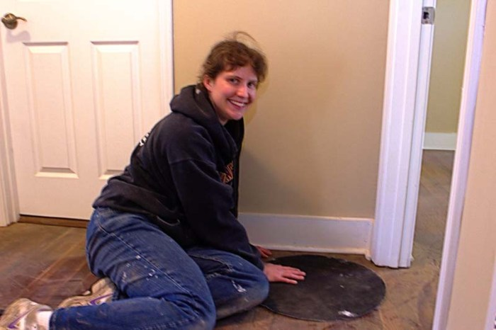 Jessica Perterson volunteering with JFA helping with some house maintenance