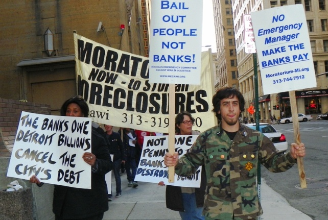 First demonstration demanding cancellation of Detroit's debt to the banks, held in downtown Detroit May 9, 2012. Significantly, the protesters also opposed an emergency manager for Detroit.