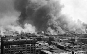 "Greenwood, also known as ""Little Africa,"" in Tulsa Oklahoma burns in 1921."