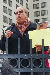 Attorney Alice Jennings speaks at rally v. bankruptcy April 1.