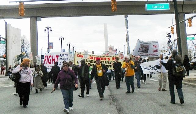 Marchers head down Woodward toward Chase Bank.