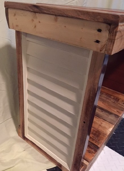 table sides have louvered panels painted off-white