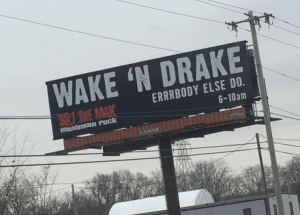 """Billboard for Wake N Drake, a morning show on a rock station that airs 6-10 am. The slogan is """"Errrbody else do."""" That's not a typo."""