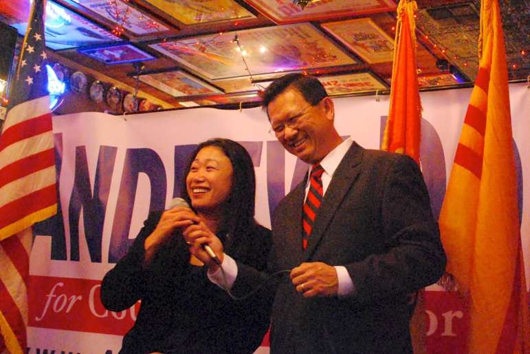 State Sen. Janet Nguyen (left) celebrates with Supervisor Andrew Do at his election party in January 2015.