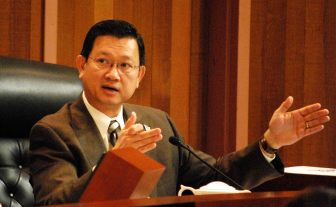 County Supervisor Andrew Do at a supervisors meeting.