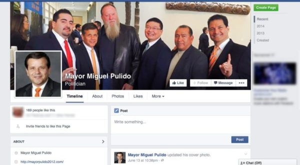 Mayor Miguel Pulido poses in a group photo with attendees of his 2015 State of the City Address. From left: Diego Olivares, Pulido, Mike Harrah, Thomas Lin, and two other men.
