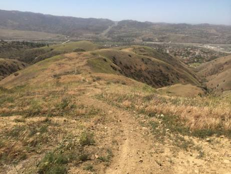 An illegal trail created on mitigation lands within Chino Hills State Park.