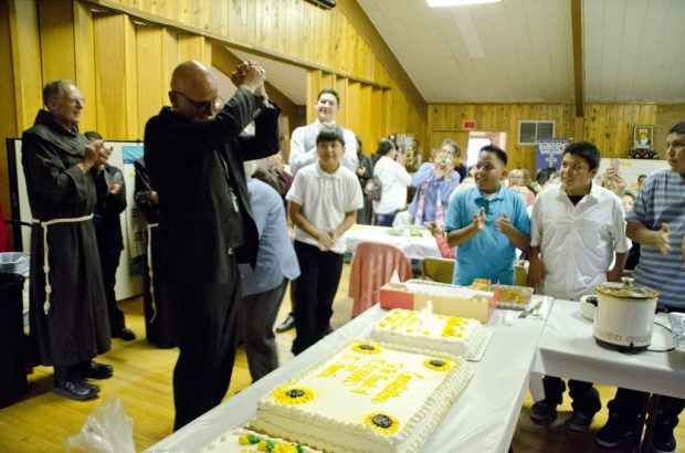The anniversary of the church also happened to be Bishop Wall's birthday. The people surprised him with a cake after the Mass.