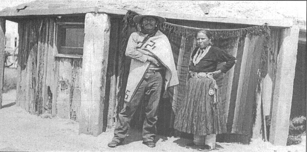 Hosteen Nez Kimble and wife at their hogan just southwest of Houck Mission.