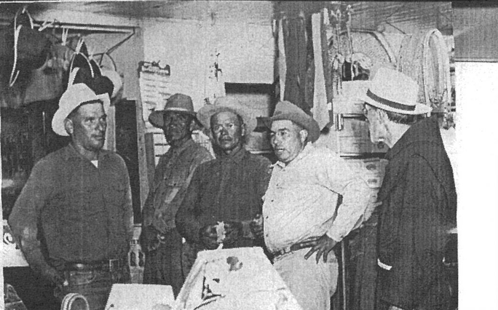 Fr. Emanuel Trockur, right, at the old trading post. From left, Roman Hubbell, John Collier, John Baldwin and Hoskie Cronemeyer.