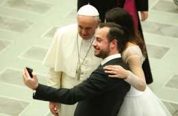 a_newly_married_couple_snaps_a_selfie_with_pope_francis_at_the_wednesday_general_audience_in_paul_vi_hall_feb_4_2015_credit_daniel_ibanez_cna_cna_2_4_15