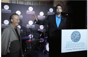 Jesus Salas presenting at charity event