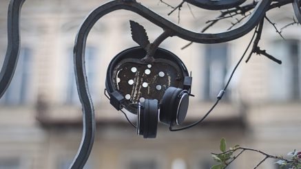 Headphones on an apple sculpture (references the Voices of the Ancestors logo). Photo by Nino Khundadze.