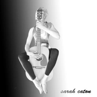 Sarah Caton floating on her guitar