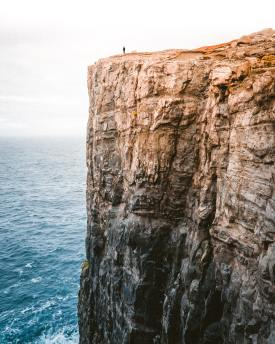 Standing along on a cliff's edge Photo by trail on Unsplash