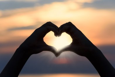 Hands making a heart, the three questions come from Love and lead to Love