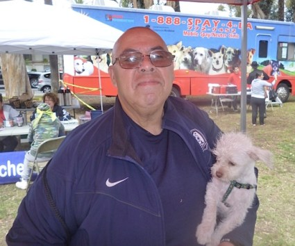 """I didn't know the community had this kind of activity to help people with their pets,"" said Rene Rodriguez, pictured here with his dog, Bebe."