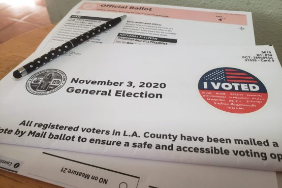 A pen lays on top of a yet to be filled ballot for the Nov. 3, 2020 general election.