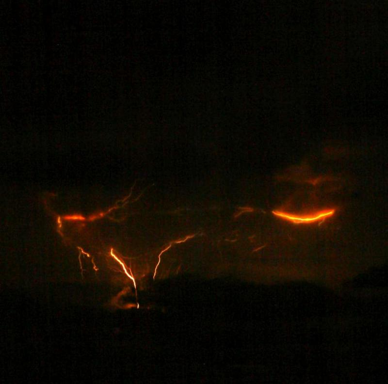 Photograph of lightning from Redoubts 1:20 am, March 28 eruption, courtesy of Bretwood Higman.