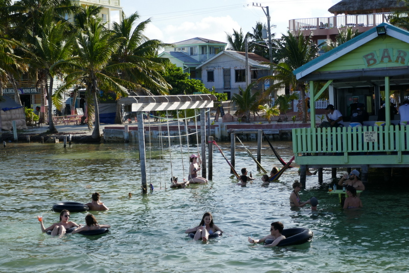 Drinking rum punch, swinging and hanging in tyres in a water bar in Caye Caulker, Belize