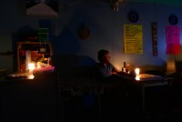 Tom during the blackout in a pupuseria in Livingston