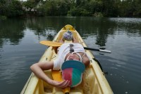 Anete on a kayak on one of the side rivers of the Rio Dulce