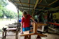 Tom sandpapering chairs at Finca Ixobel in Poptún, Guatemala