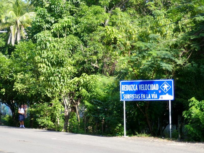 Slow down for surfers, sign near El Tunco in El Salvador.