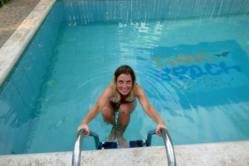Anete climbing out of the pool at Tunco Beach Hostal in El Tunco, El Salvador.