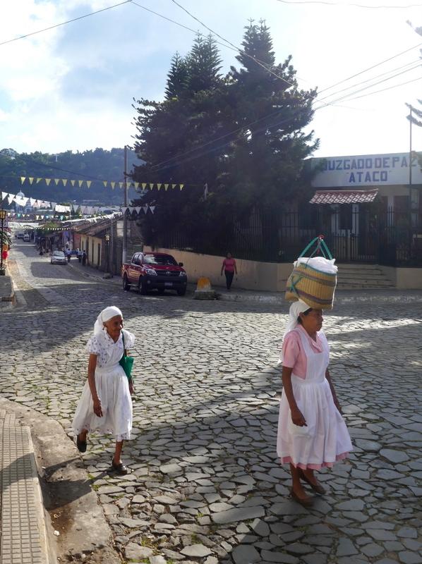 Old ladies walk the streets of Ataco, Ruta de las Flores.