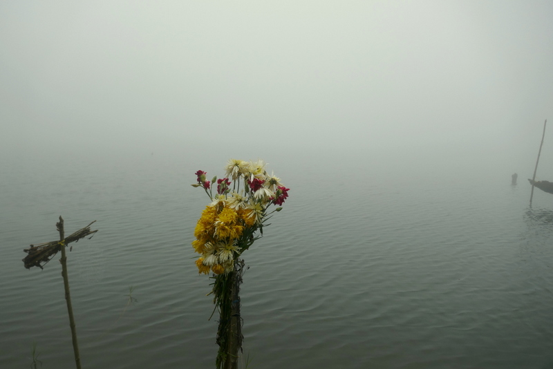 Flower donations in Laguna Chicabal near Xela.