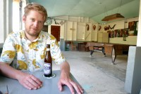 Tom drinks a Belikin Stout in the South Side Cool Bar.