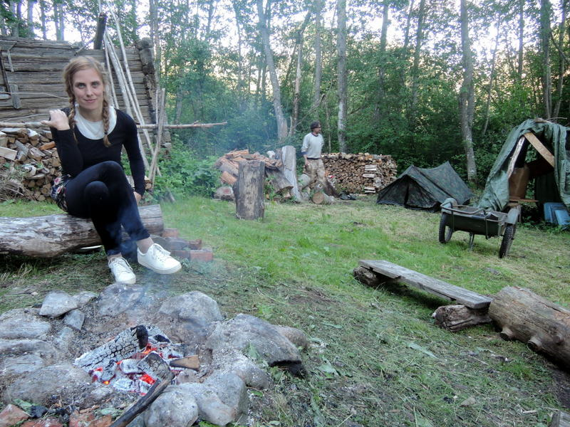 Anete around the fire during Midsummer in Estonia.