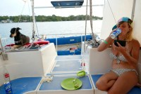 Anete drinks Dorada Ice on a boat in Lake Izabal.