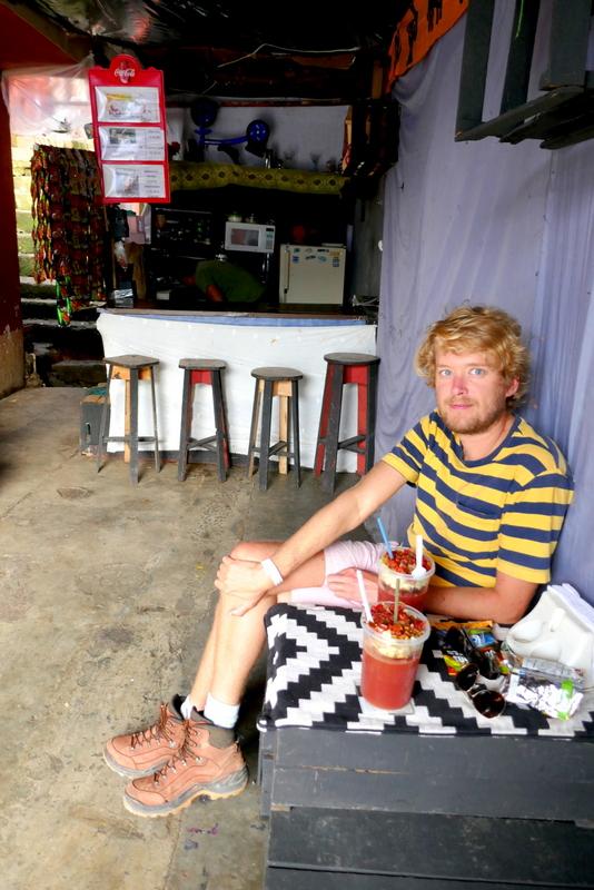 Tom drinks michelada in a nameless shack in Cobán, Guatemala.