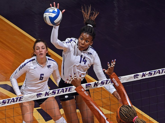 """Meley Vernon-Kansas State volleyball-K-State """"width ="""" 696 """"tall ="""" 522 """"srcset ="""" https://volleyballmag.com/wp-content/uploads/2019/10/K-States-Megan-Vernon- -6-over-the-Texas-block-as-teammate-Jacque-Smith-Breath-on-Scott-D.-Weaver-K-State-Athletics.jpeg 696w, https://volleyballmag.com/wp- / upload / 2019/10 / K-States-Megan-Vernon-T-up-over-The-Texas-block-as-teammate-Jacque-Smith-Breath-on-Scott-D.-Weaver-K-State -Athletics-300x225.jpeg 300w, https://volleyballmag.com/wp-content/uploads/2019/10/K-States-Megan-Vernon-goes-up-over-the-Texas-block-as-teammate- Jacque-Smith-Breath-on-Scott-D.-Weaver-K-State-Athletics-80x60.jpeg 80w, https://volleyballmag.com/wp-content/uploads/2019/10/K-States-Megan- 265w, https: // volleyballmag - Vernon-to-up-the-Texas-block-as-teammate-Jacque-Smith-Breath-on-Scott-D.-Weaver-K-State-Athletics-265x198.jpeg. com / wp-content / uploads / 2019/10 / K-States-Megan-Vernon-to-up-over-the-Texas-block-as-teammate-Jacque-Smith-Breath-on-Scott-D.-Weaver -K-State-Athlet ics-560x420.jpeg 560w """"size ="""" (maximum width: 696px) 100vw, 696px"""